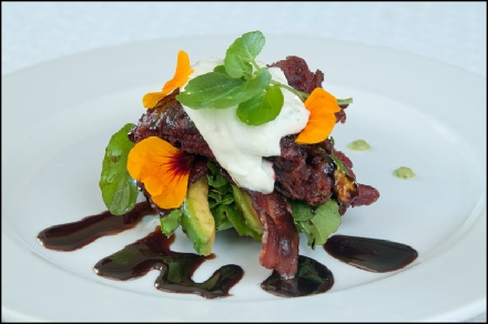 Beetroot fritter stack with smoked salmon, avocado and sour cream and balsamic reduction